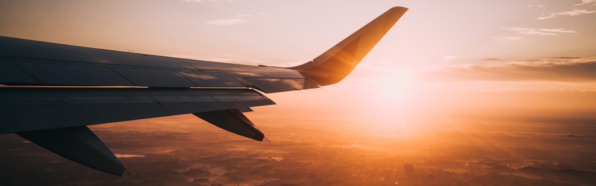Airplane wing at Sunset