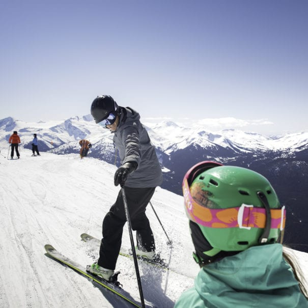 Father and daughter skiing a groomed trail in Whistler Blackcomb